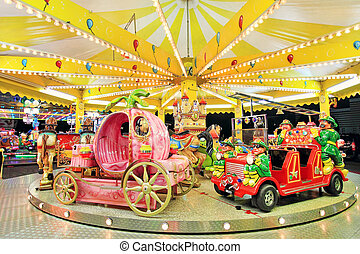 Carousel in Luna Park. - Round carousel with firefighter's...