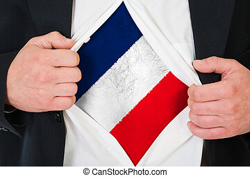 The French flag painted on the chest of a man