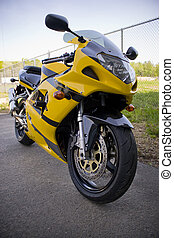 Yellow Motorcycle - A brand new yellow motorcycle - modern...