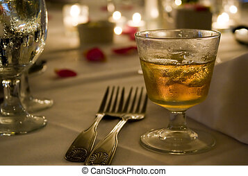 Scotch on the Rocks - A glass of golden hard liquor on the...
