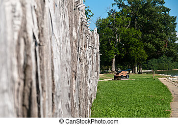 Jamestown Fort - Wooden fortress wall with spikes and canon...