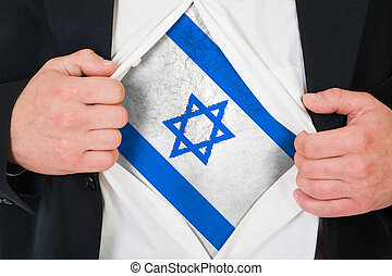 The Israeli flag painted on the chest of a man