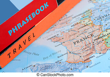 world travel - world map with travel and phrase books on top...