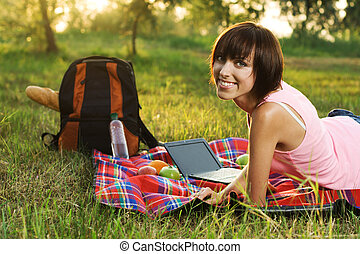 Lovely girl on picnic in the park - Lovely girl having a...