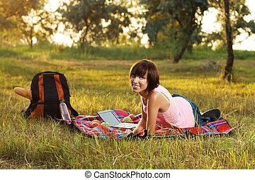 Lovely girl on picnic in the park - Lovely girl having a...