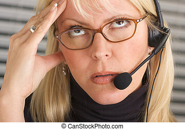 Businesswoman with Phone Headset and Headache -...
