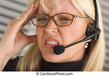 Headache -Businesswoman - Businesswoman with phone headset...