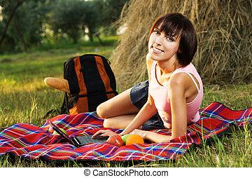 Lovely girl having a rest in the park