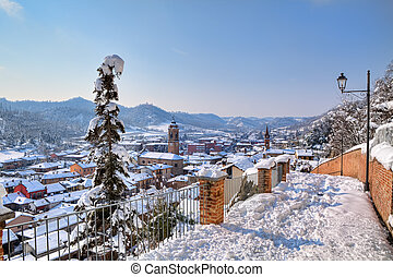 Town under the snow. Corneliano D'Alba, Italy. - Aerial view...
