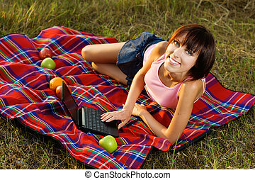 Lovely girl having a rest outdoors - Lovely girl having a...