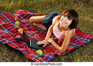Lovely girl having a rest outdoors - Lovely girl having a...