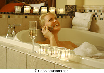 Woman in Bath Using Cell Phone