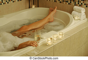 Woman Relaxes in Bath - Beautiful Woman in bubble bath with...