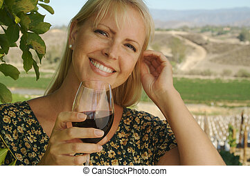 Blond Girl Sips Wine - Attractive Woman Sips Wine at a...
