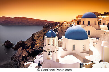 Santorini Sunset - Churches on Santorini Cliffs with orange...