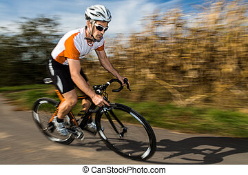 triathlete in cycling - triathlete on a bicycle