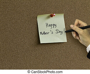 "Hand writing "" thank you "" in paper note on cork board background"