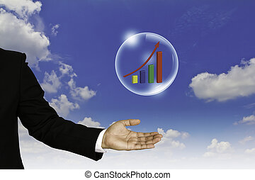 Business graph in bubble over business man hand against blue sky