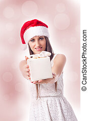 Woman is giving a gift - beautiful woman with christmas hat...