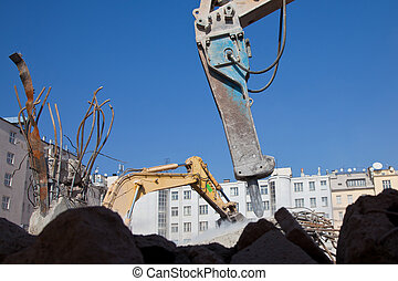 Hydraulic hammer crushing old construction