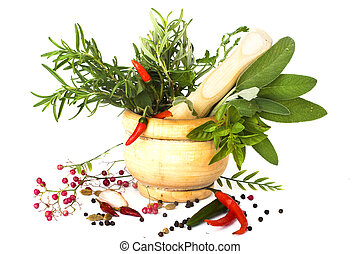 Mixed herbs of sage, rosemary, basil with red hot peper in mortar with pestle on white background