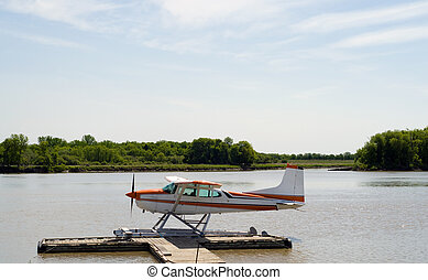 Seaplane - A seaplane parked along a wooden dock on the...
