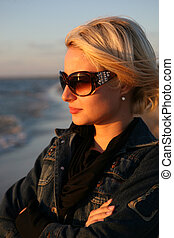 Young woman  look on sunset