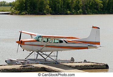 Small Plane - A small aeroplane docked on a river