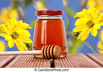 natural honey with yellow flowers