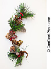 Christmas ornament with pine cones on white background