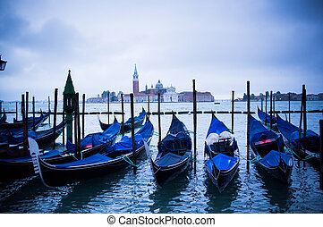 Gondolas at St Marco Square in Venice, Italy - Gondolas at...