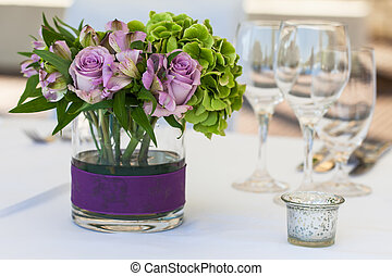 Flowers on a table - A purple rose center piece on the table...