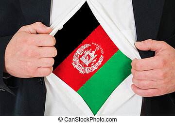 The Afghan flag painted on the chest of a man