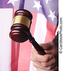 american court, gavel in front of an american flag