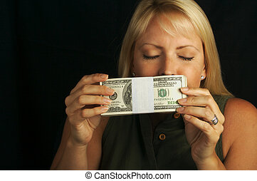 The Smell of Money - Attractive Woman Enjoys the Smell of...