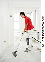 worker cleaning floor at home renovation - Worker cleaning...