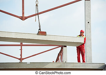 builder worker installing concrete slab - Construction...