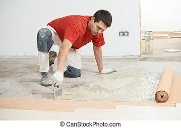 Parquet Floor work with - Worker carpenter doing parquet...
