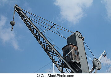 Old crane and Bigo structure at the port of Genoa