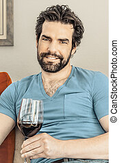 man with wine - An image of a handsome man with a glass of...