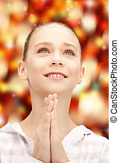 praying teenage girl - bright closeup portrait picture of...