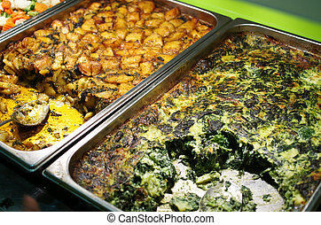 Catering buffet with spinach and tomato