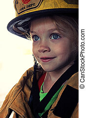 Girl as Firefighter - A young girl dressed up as a...