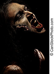 vampire witch - Close-up of a bloodthirsty zombie over black...