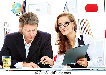 working together - Business woman and businessman working...