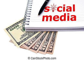 social media concept - Notebook and dollars, social media...