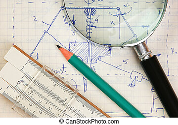 magnifying glass and a slide rule on the old page with the...