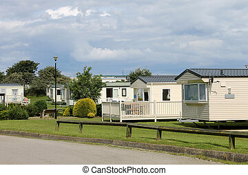 Scenic view of caravan trailer park with road in foreground...