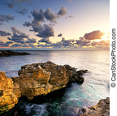 Beautiful seascape. Sea and rock at the sunset. Nature...