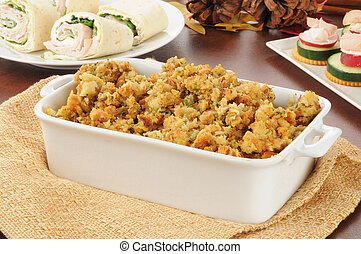 turkey stuffing - A baking dish with turkey stuffing and...